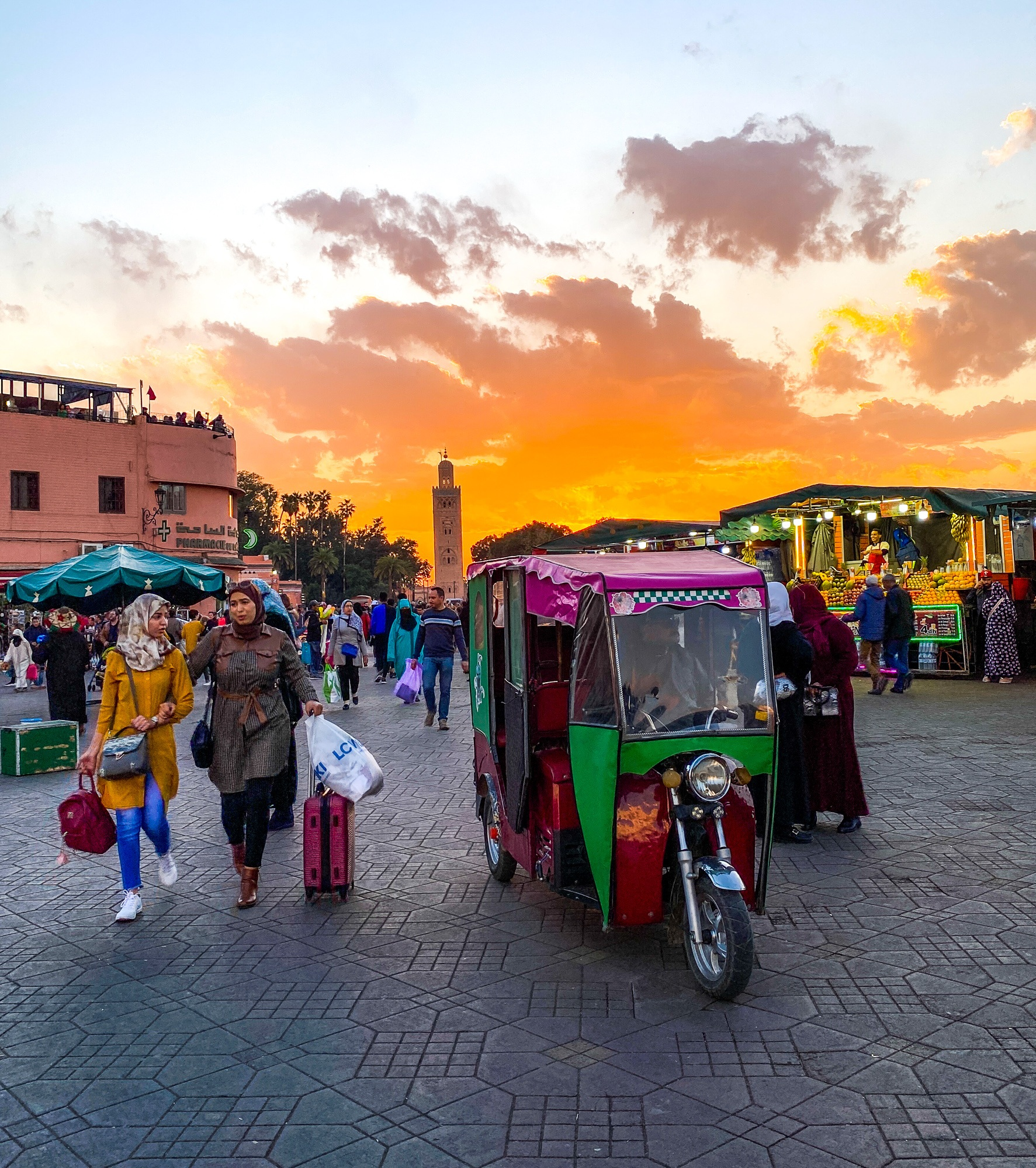 Shoppers and a tuktuk in Marrakech's medina