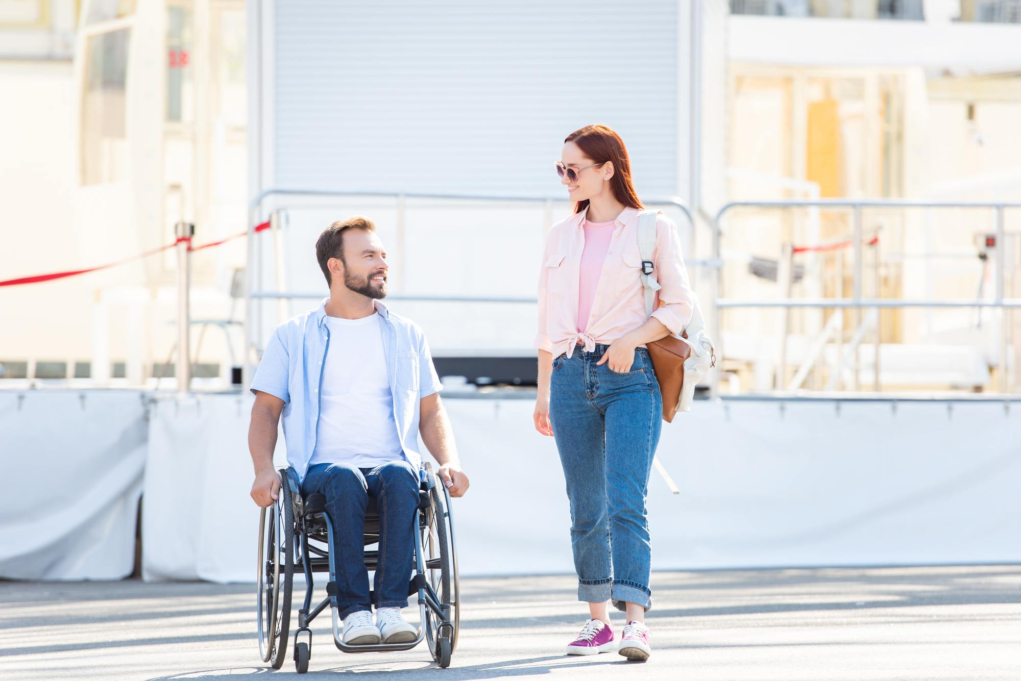 Man in wheelchair with standing woman