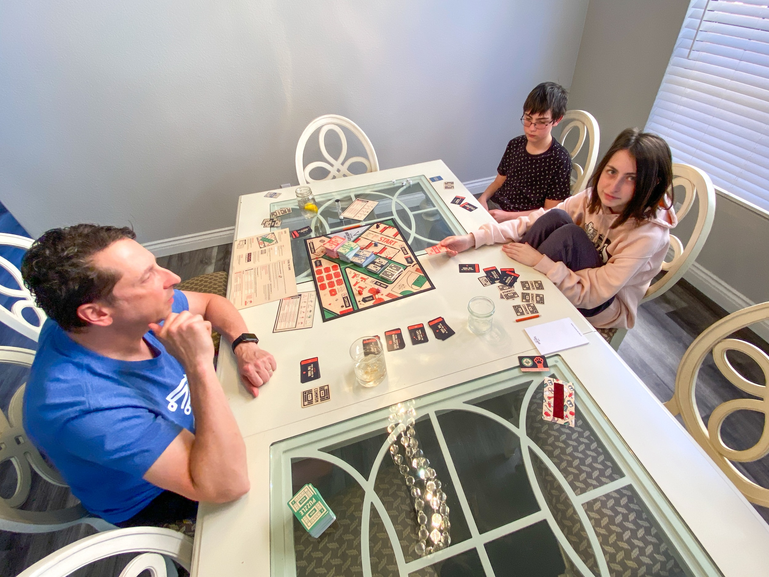 Family playing Escape from Iron Gate board game