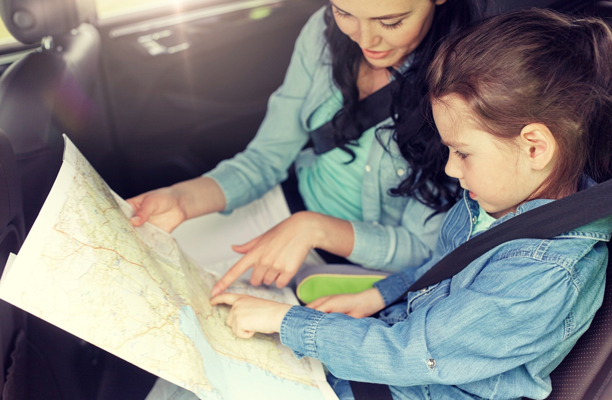 Kids like to follow along via paper maps during car trips