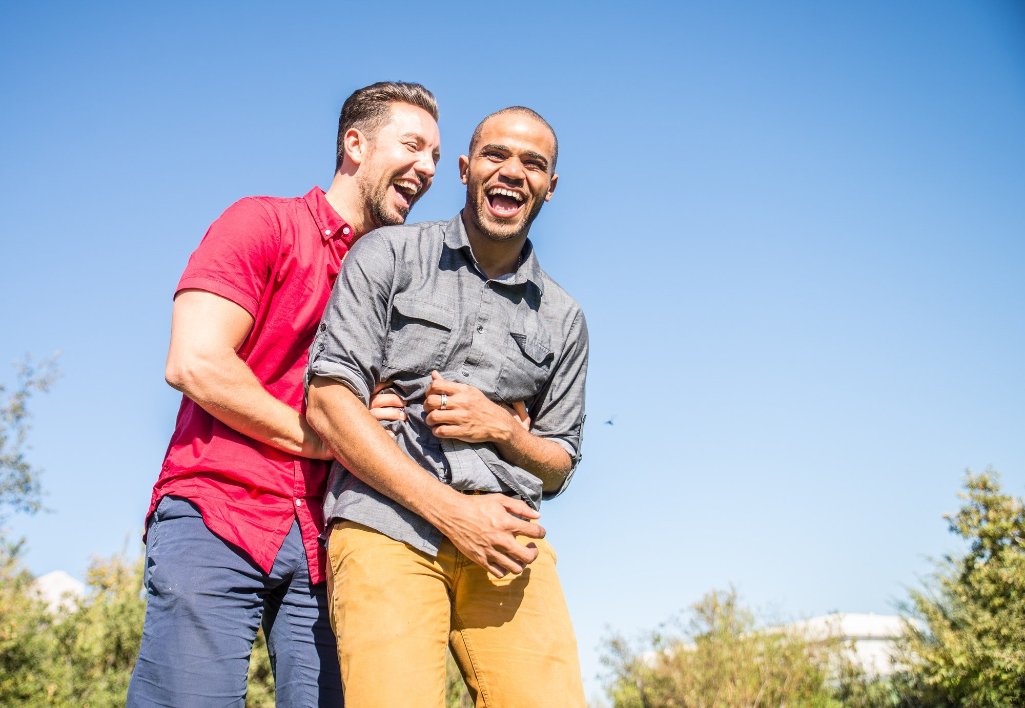 Gay male couple laughing