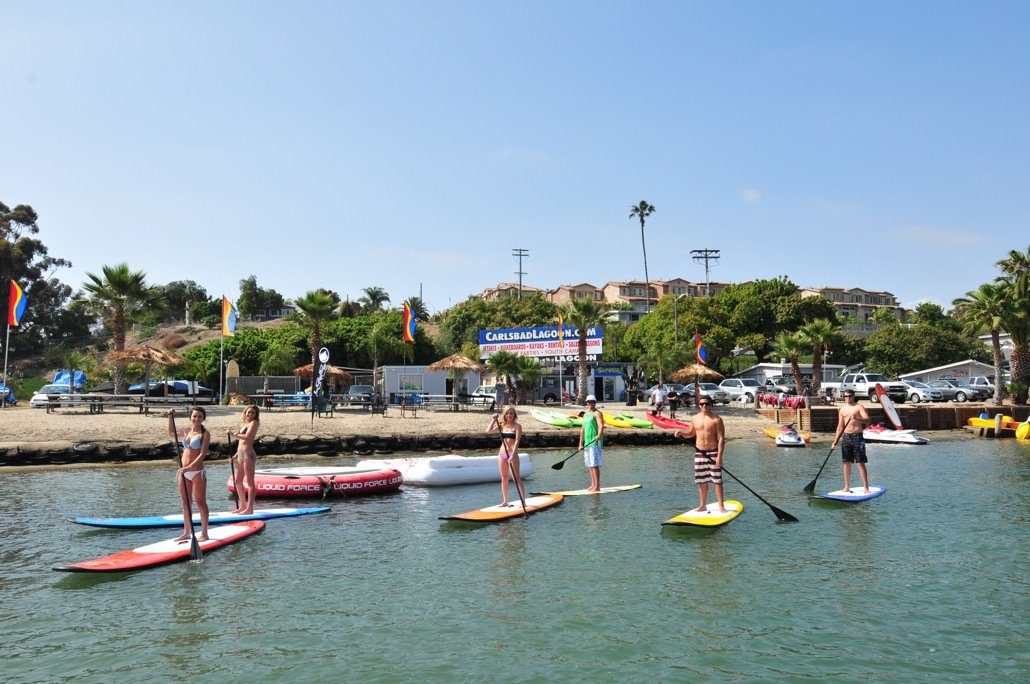 Stand-up paddle boarders on Carlsbad Lagoon