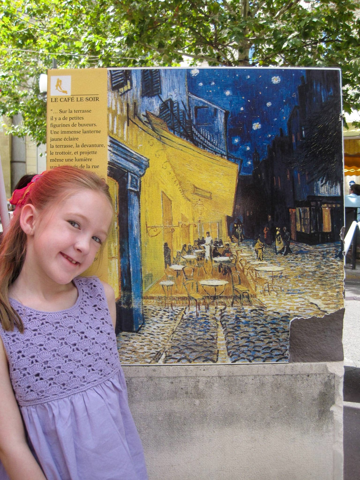 Little girl with Van Gogh posted in Provence