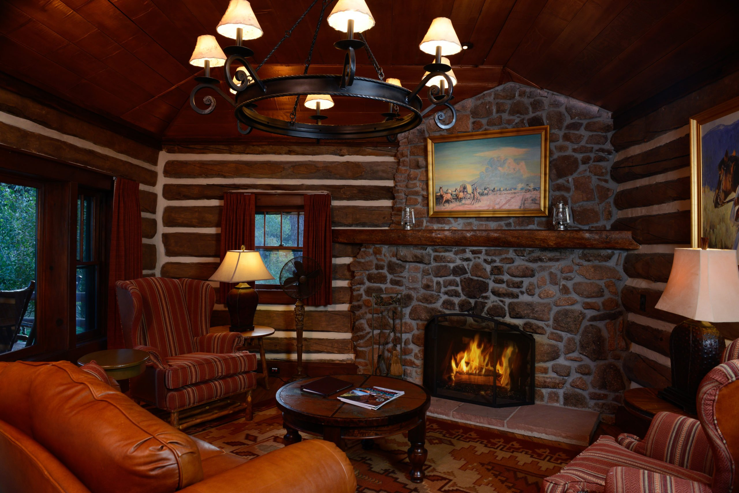 Copper Cabin living area with fireplace at Broadmoor Ranch