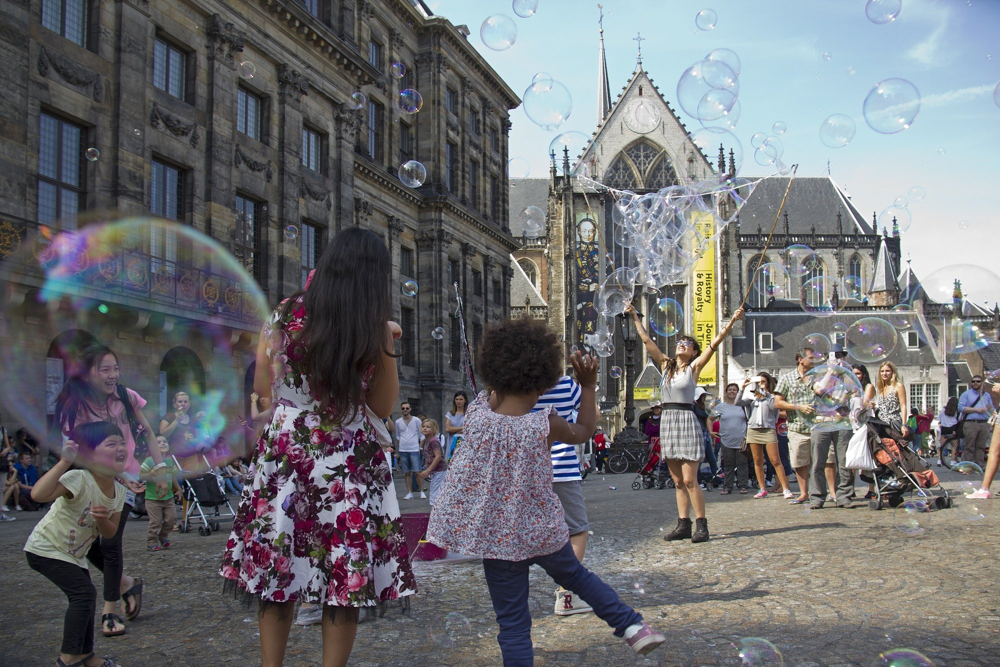 Kids dancing in Dam Square in Amsterdam
