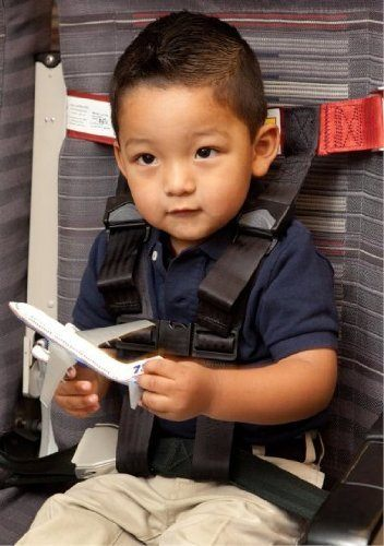 Little boy secured in a CARES kids airplane harness