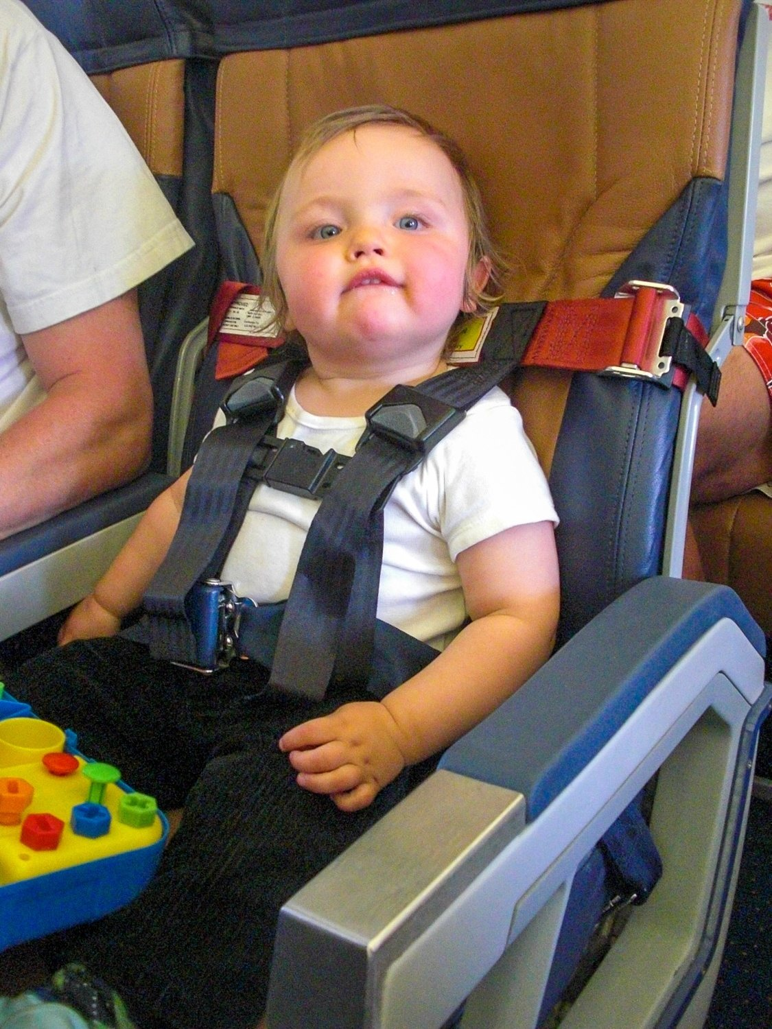 My toddler in a CARES airplane harness
