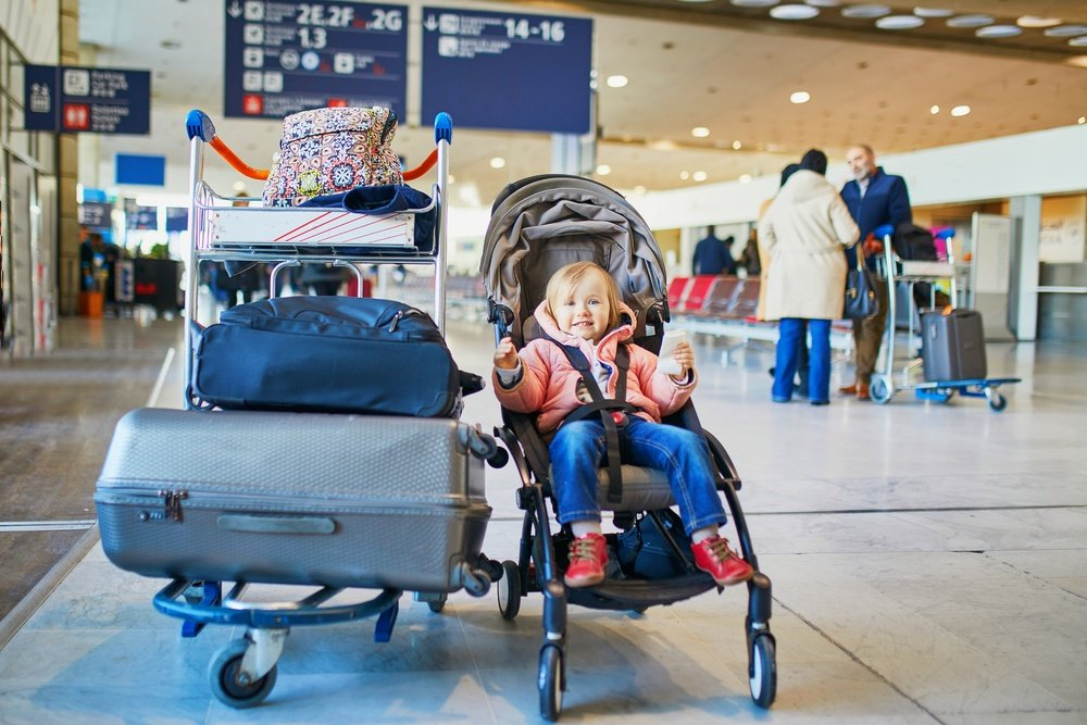 Toddler and luggage in airport