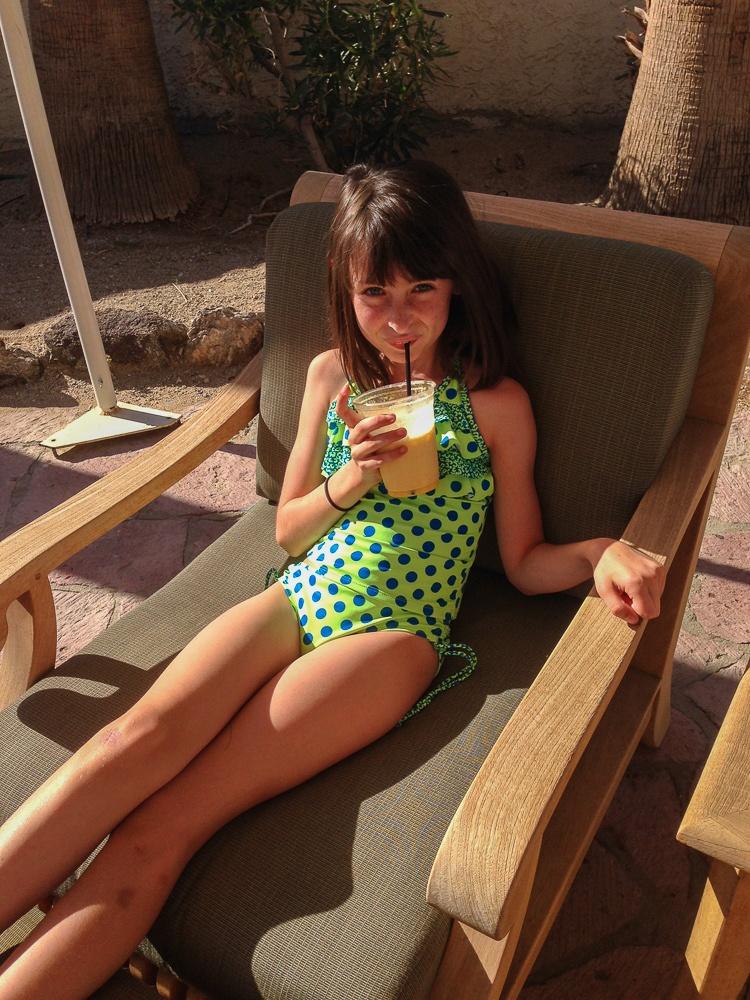 Tween with smoothie by pool at La Casa Del Zorro