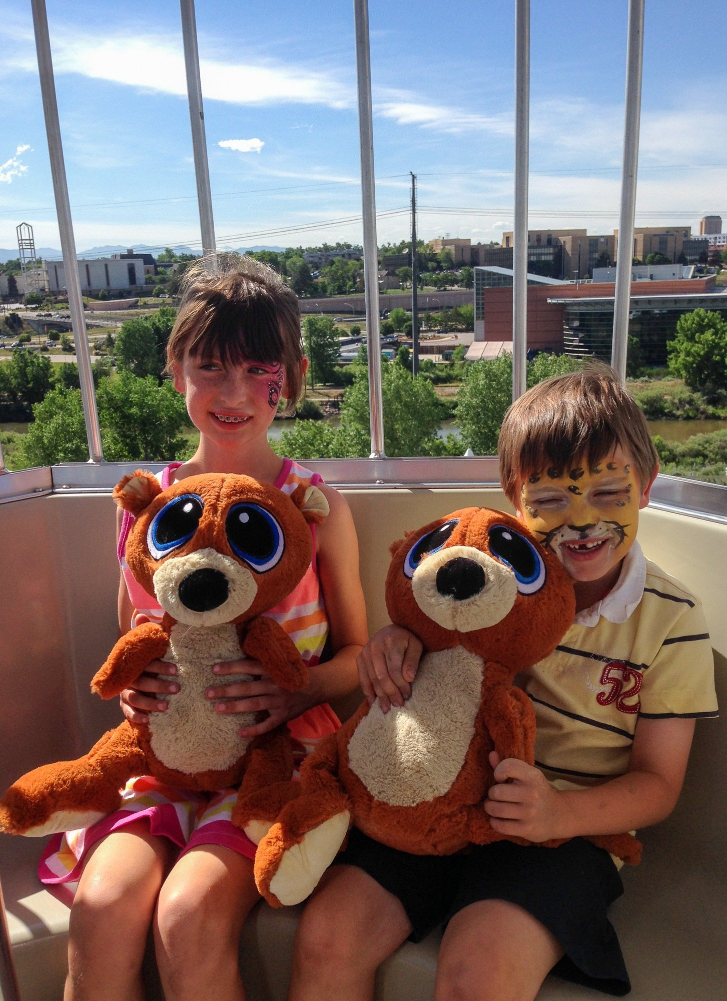 Kids with their Elitch Gardens carnival prizes