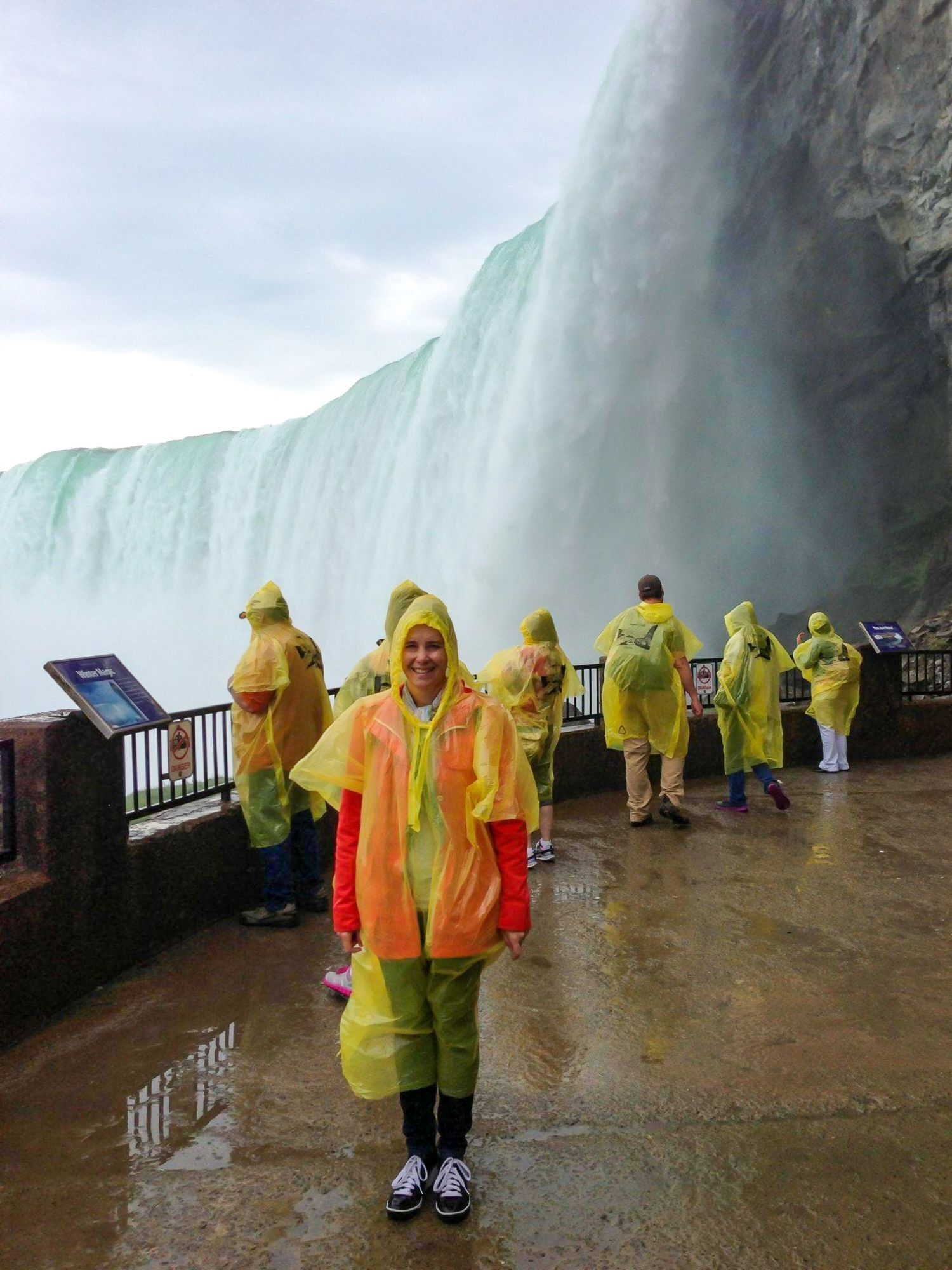 Me in my sleek yellow poncho at Journey Behind the Falls