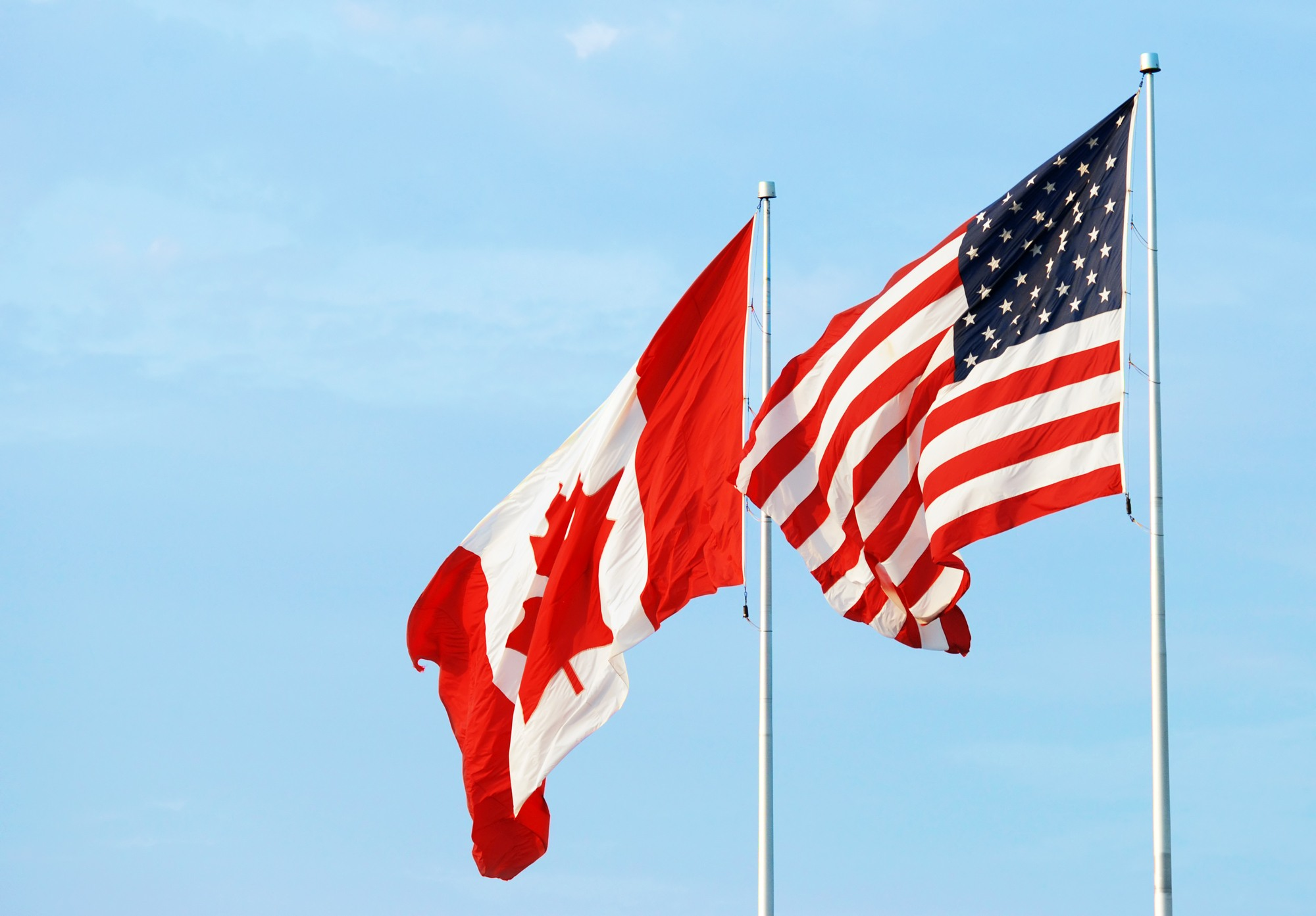 Canadian and American flags together