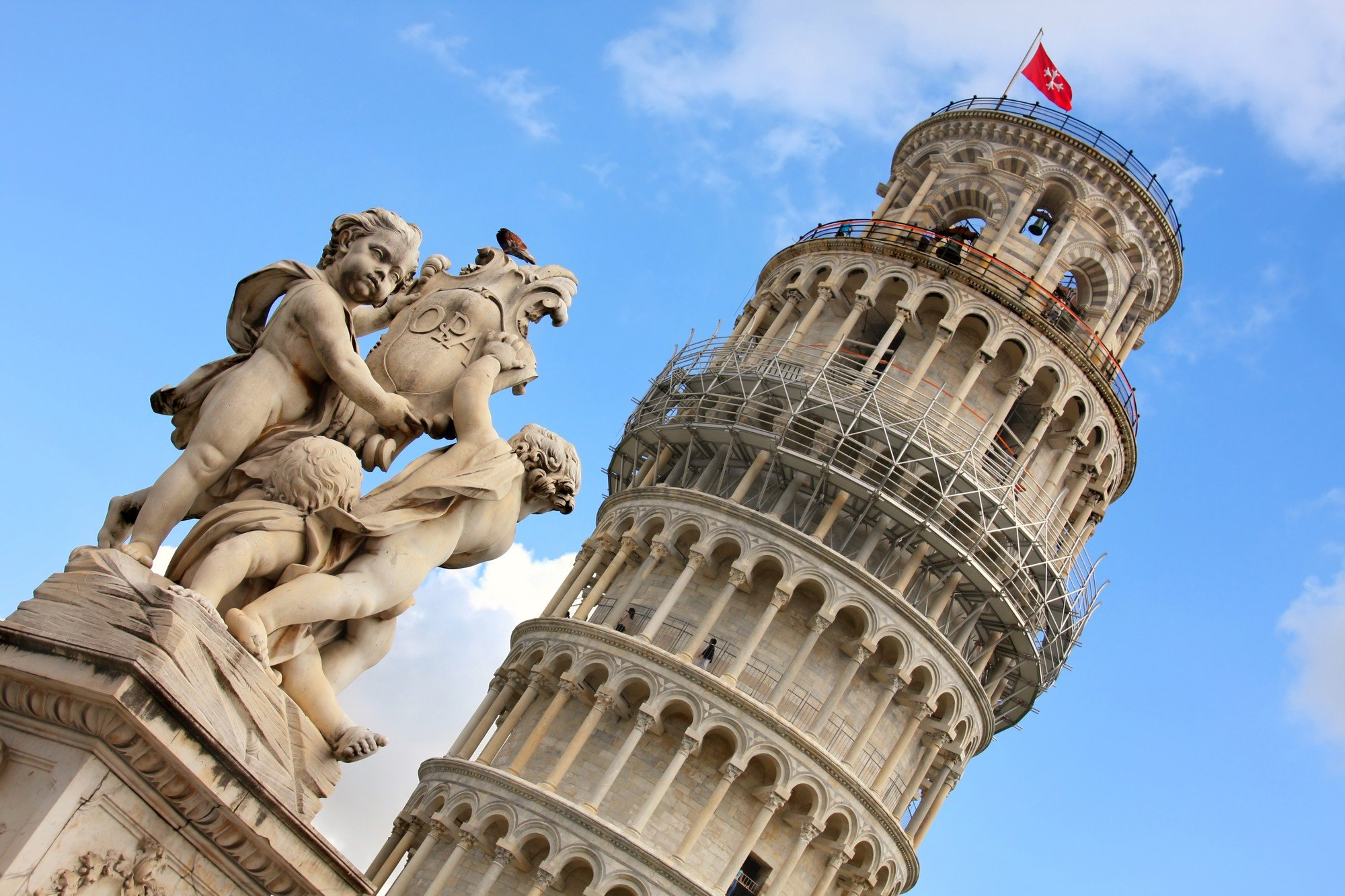 Leaning Tower and angel statue in Pisa