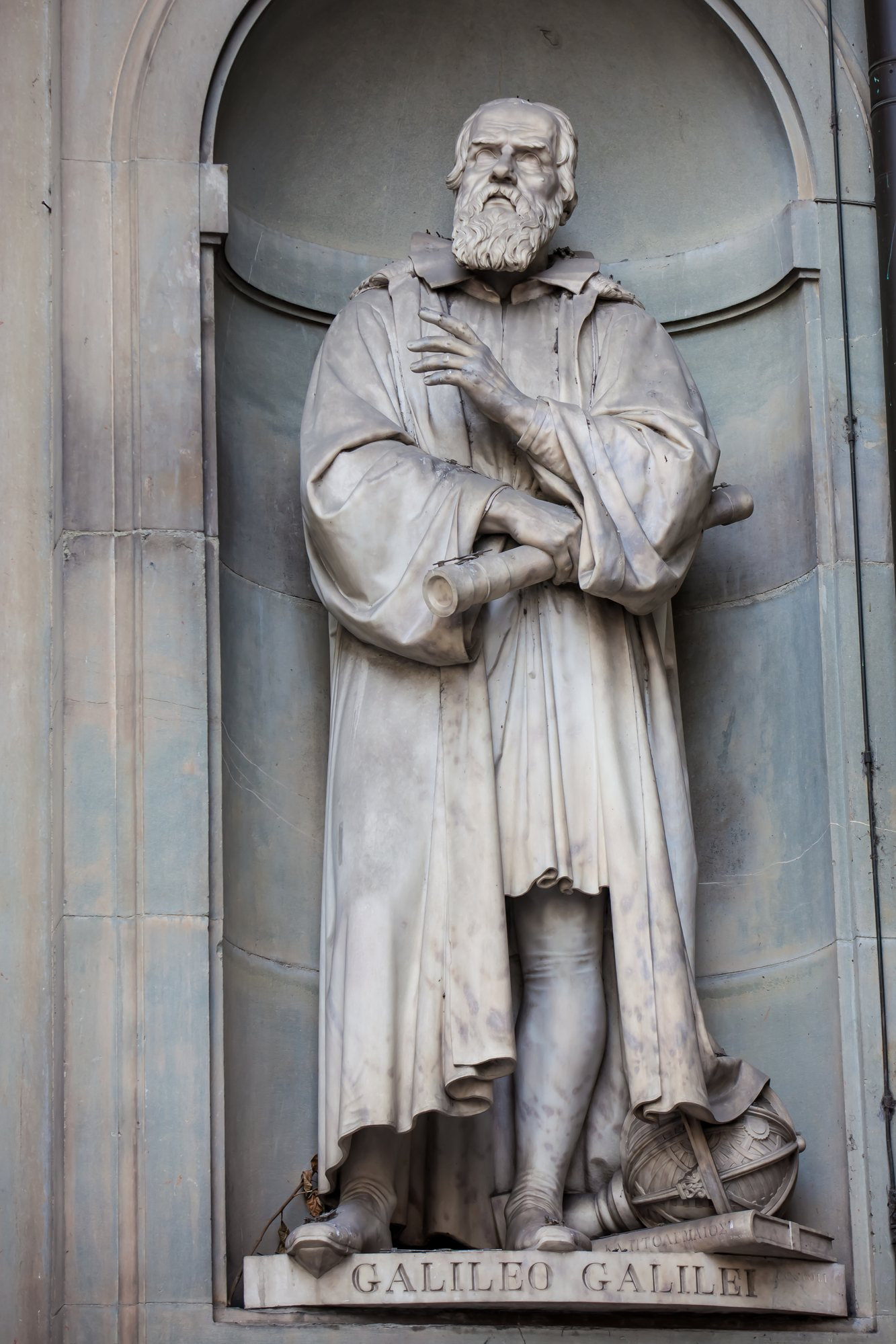 Statue of Galileo Galilei at the courtyard of the Uffizi Gallery in nearby Florence