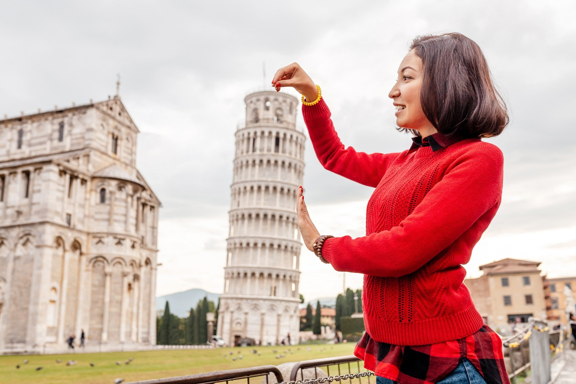 Tourists love to pretend to hold up the Leaning of Tower of Pisa