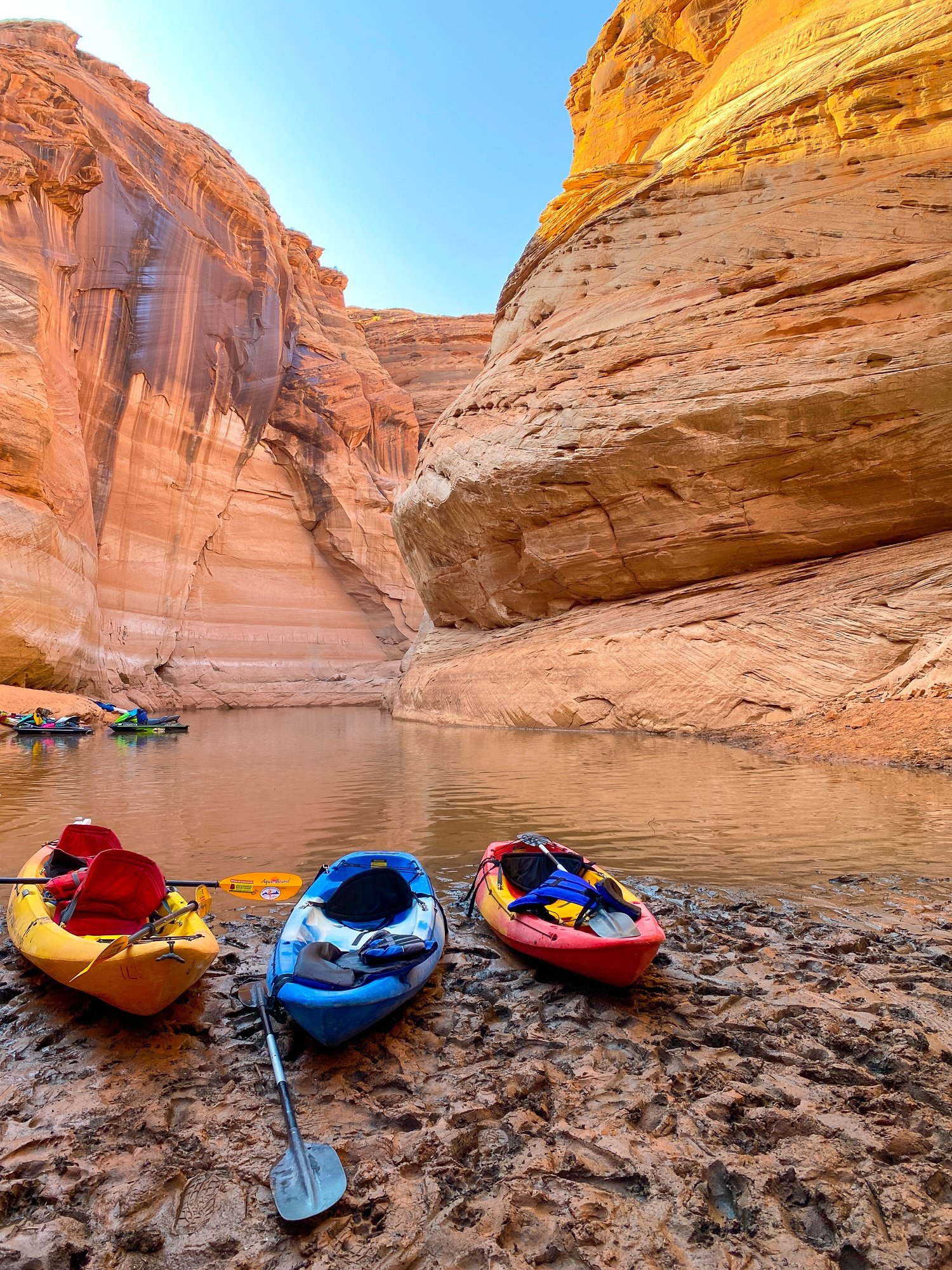 Kayaks docked on the shore of Lake Powell in Antelope Canyon