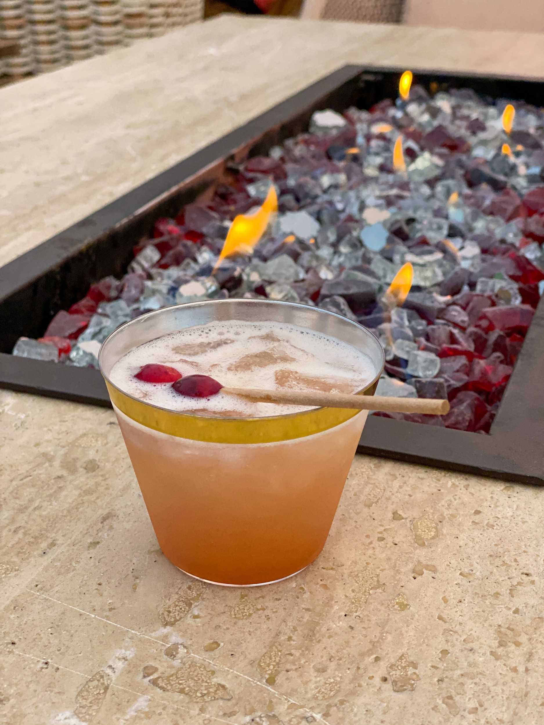 Good Tidings cocktail, made with vodka, Cointreau, citrus, cranberry, and All Spice Dram at Fairmont Scottsdale Princess