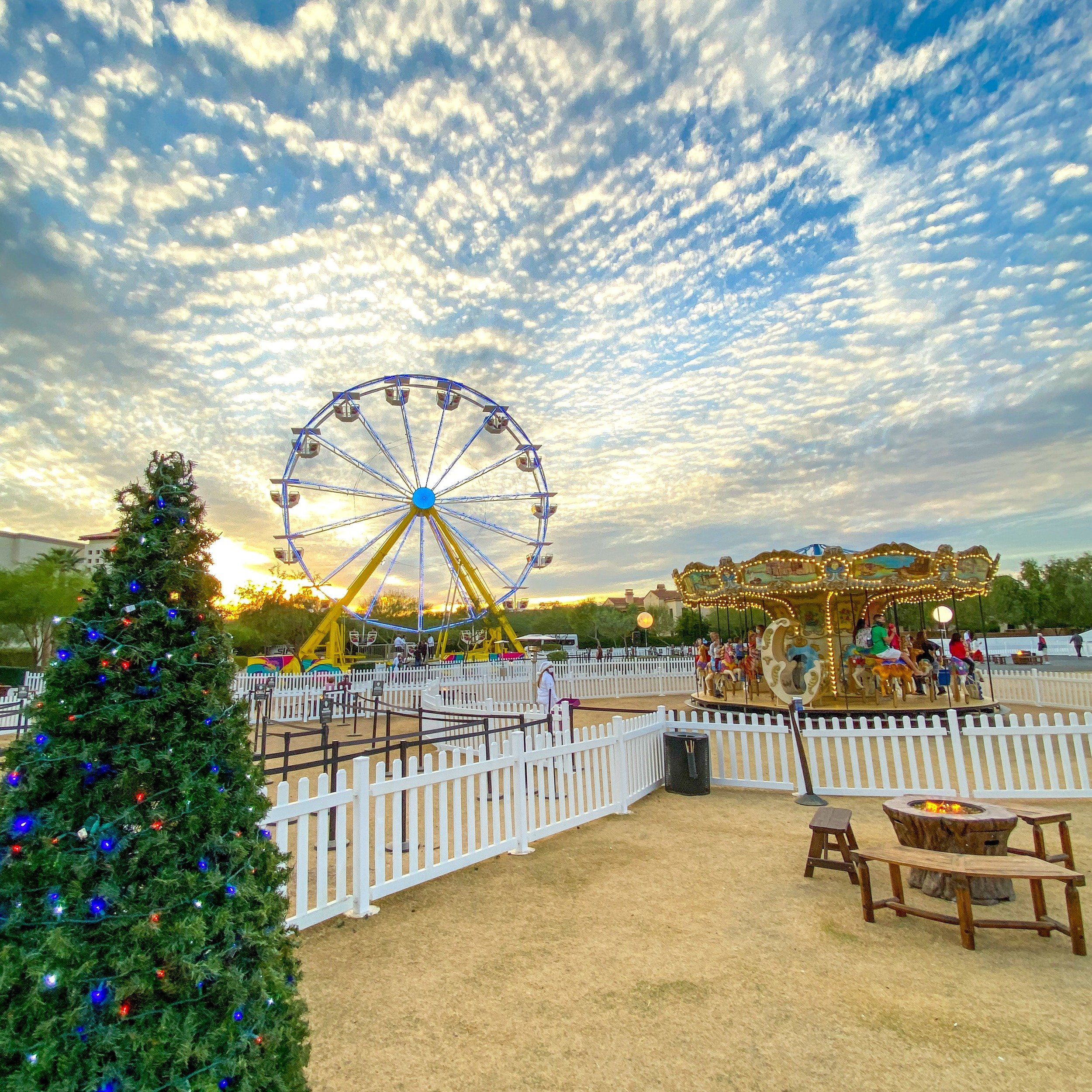 Frosty's Ferris Wheel, Christmas Carousel and one of many fire pits in S'moresland at Fairmont Scottsdale Princess