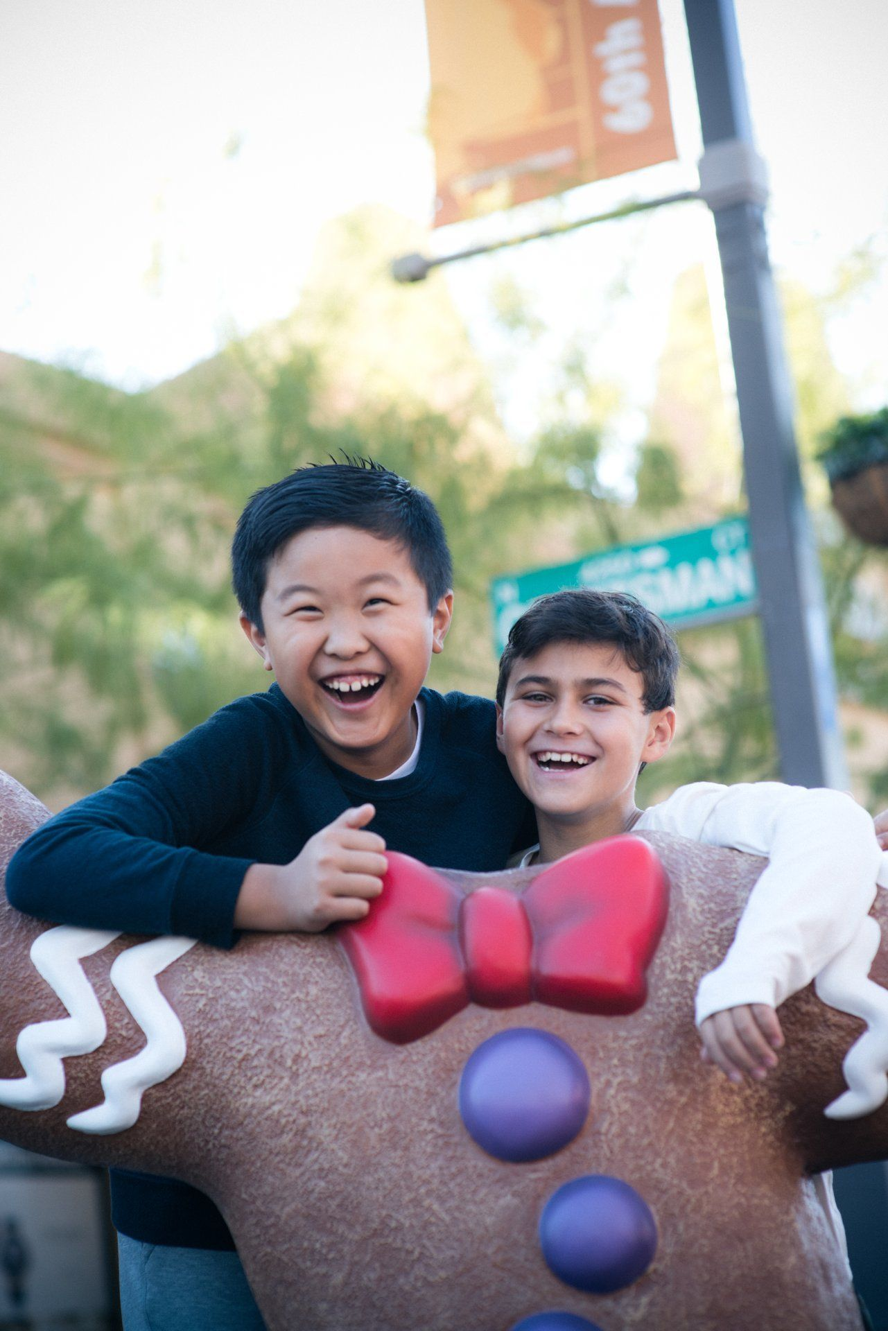 Pose with a gingerbread man in Old Town Scottsdale during Scottsdazzle