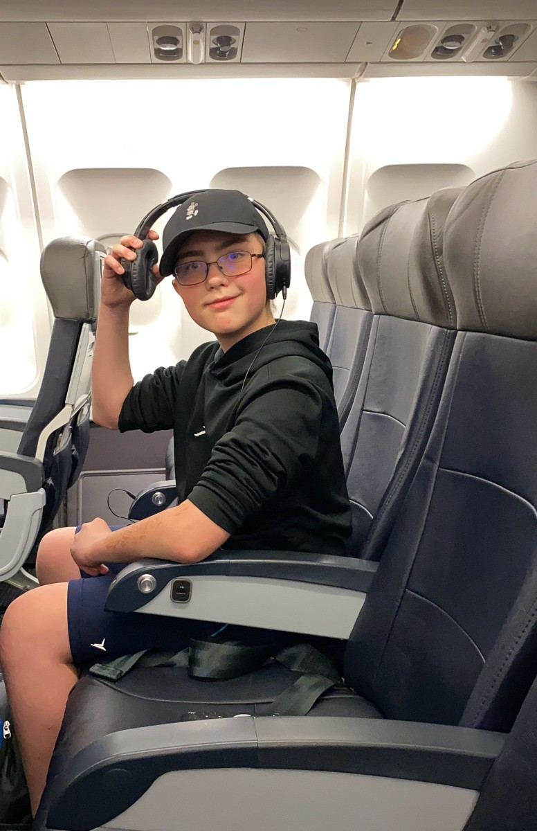 Tween watching movie on a long airplane flight