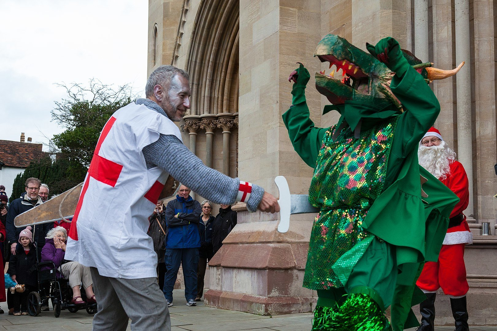 Saint George kills the dragon in a mummers' play in Great Britain