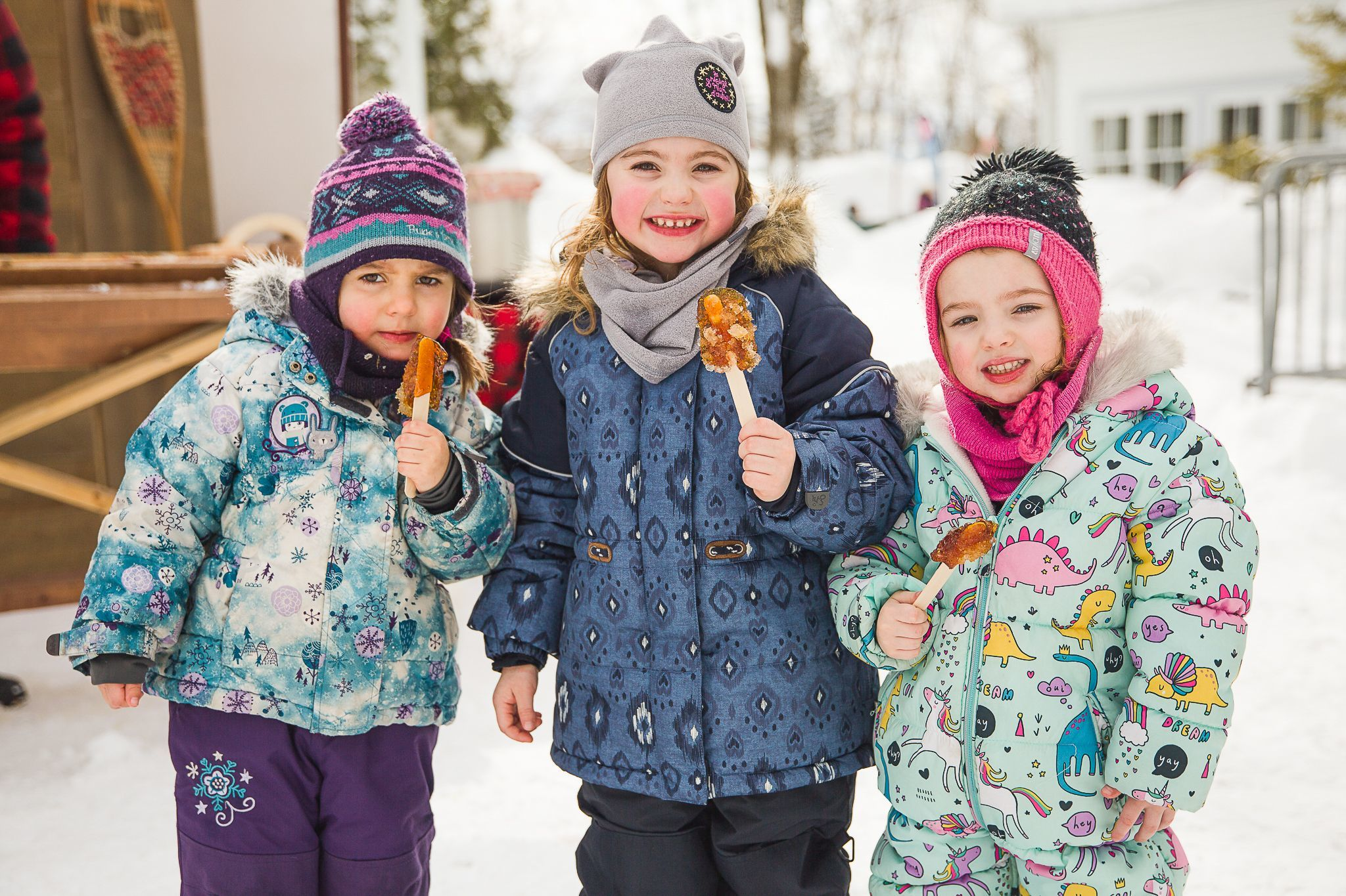 Kids enjoying maple taffy at the Quebec Winter Carnival