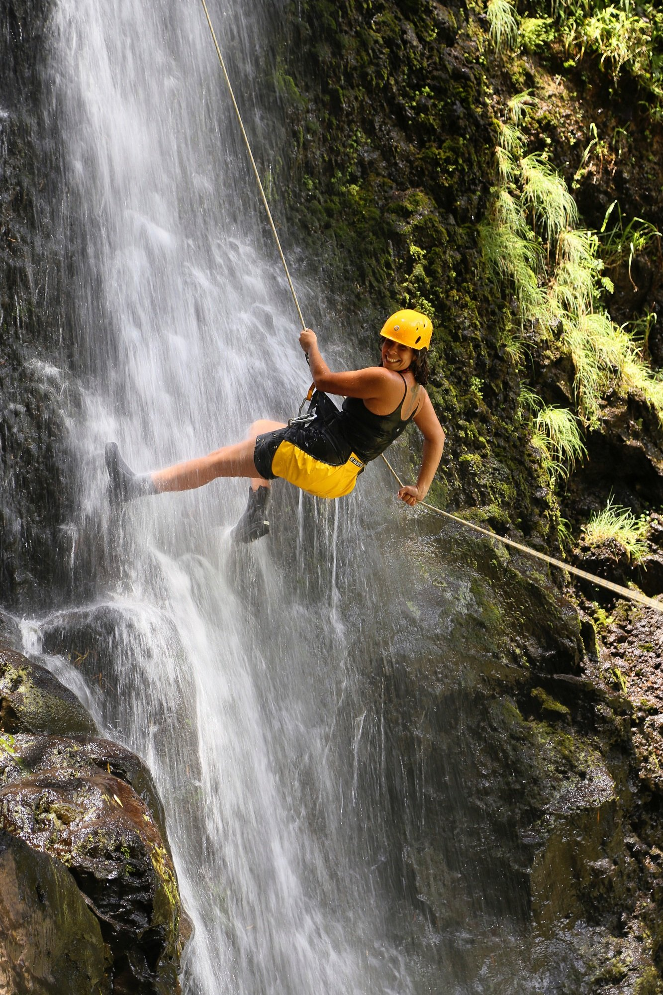 Rappeling down a waterfall in Maui