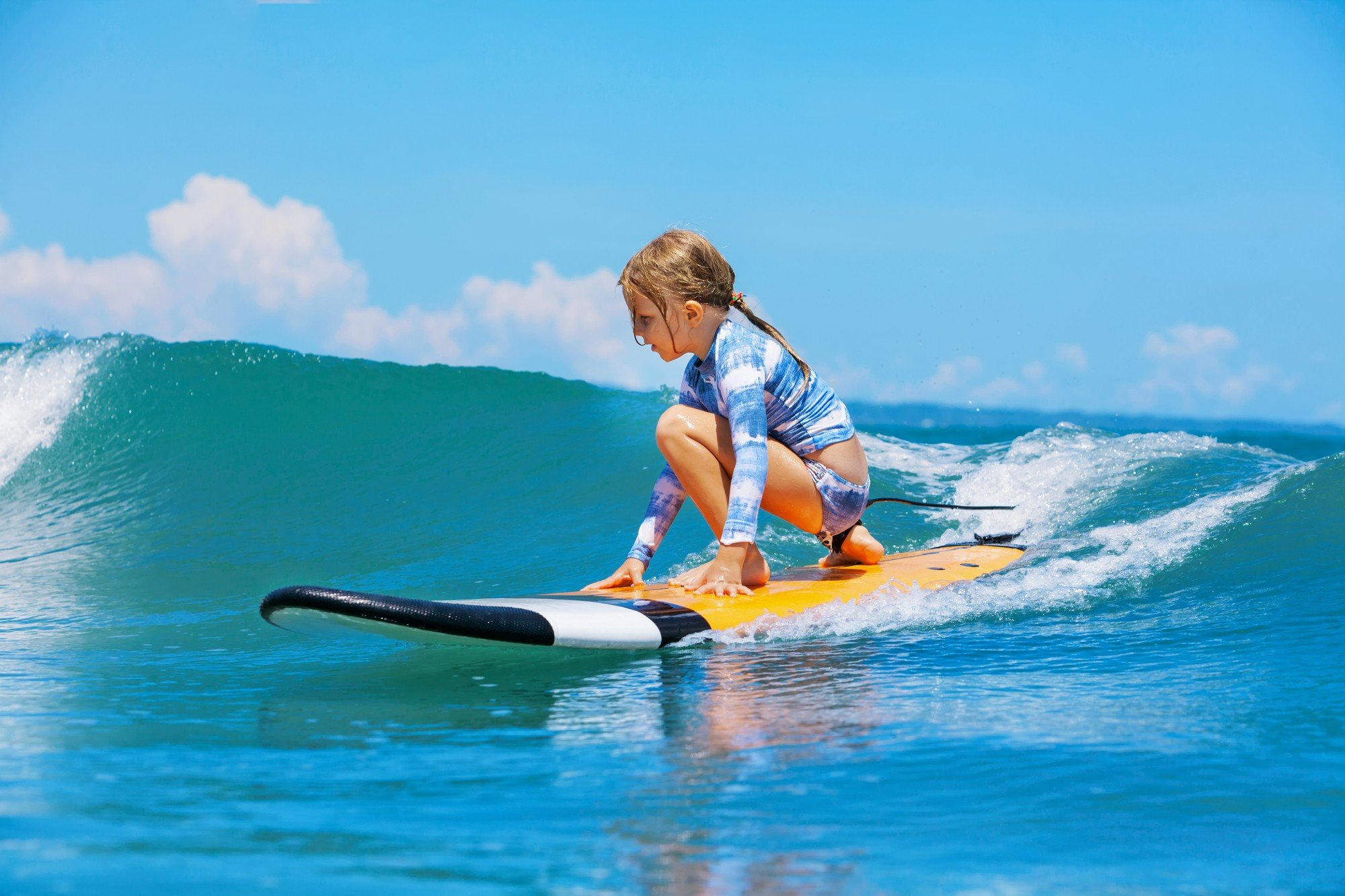 Maui is an ideal place to learn to surf with kids