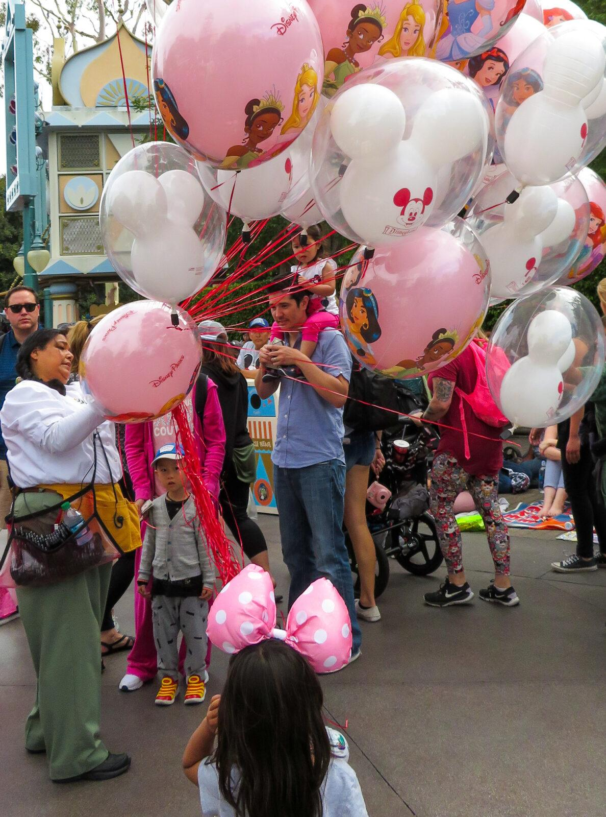 Balloons for sale at Disneyland with kids