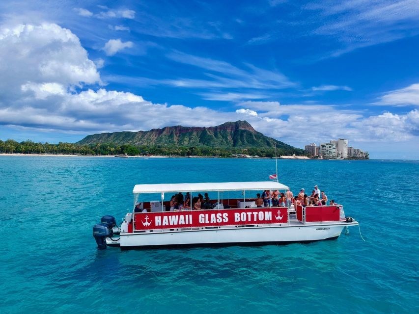 Hawaii Glass Bottom Boat Tour in Oahu with kids with Diamond Head in the background