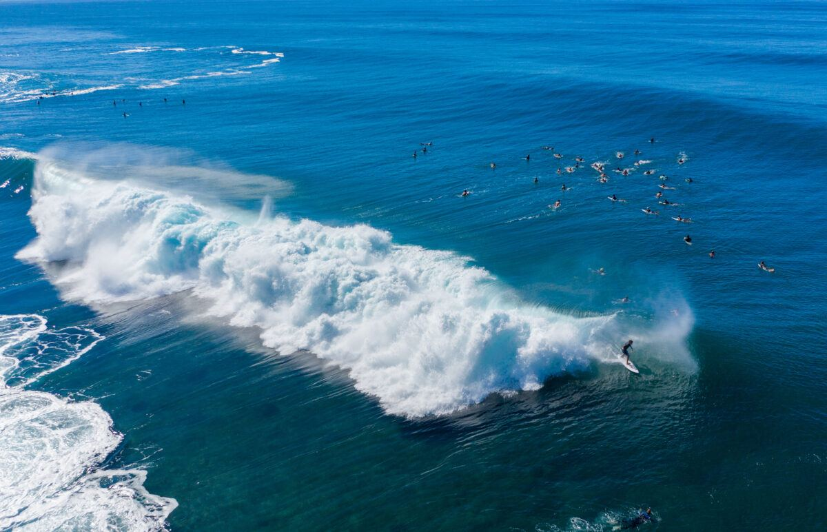 Surfers on the North Shore of Oahu
